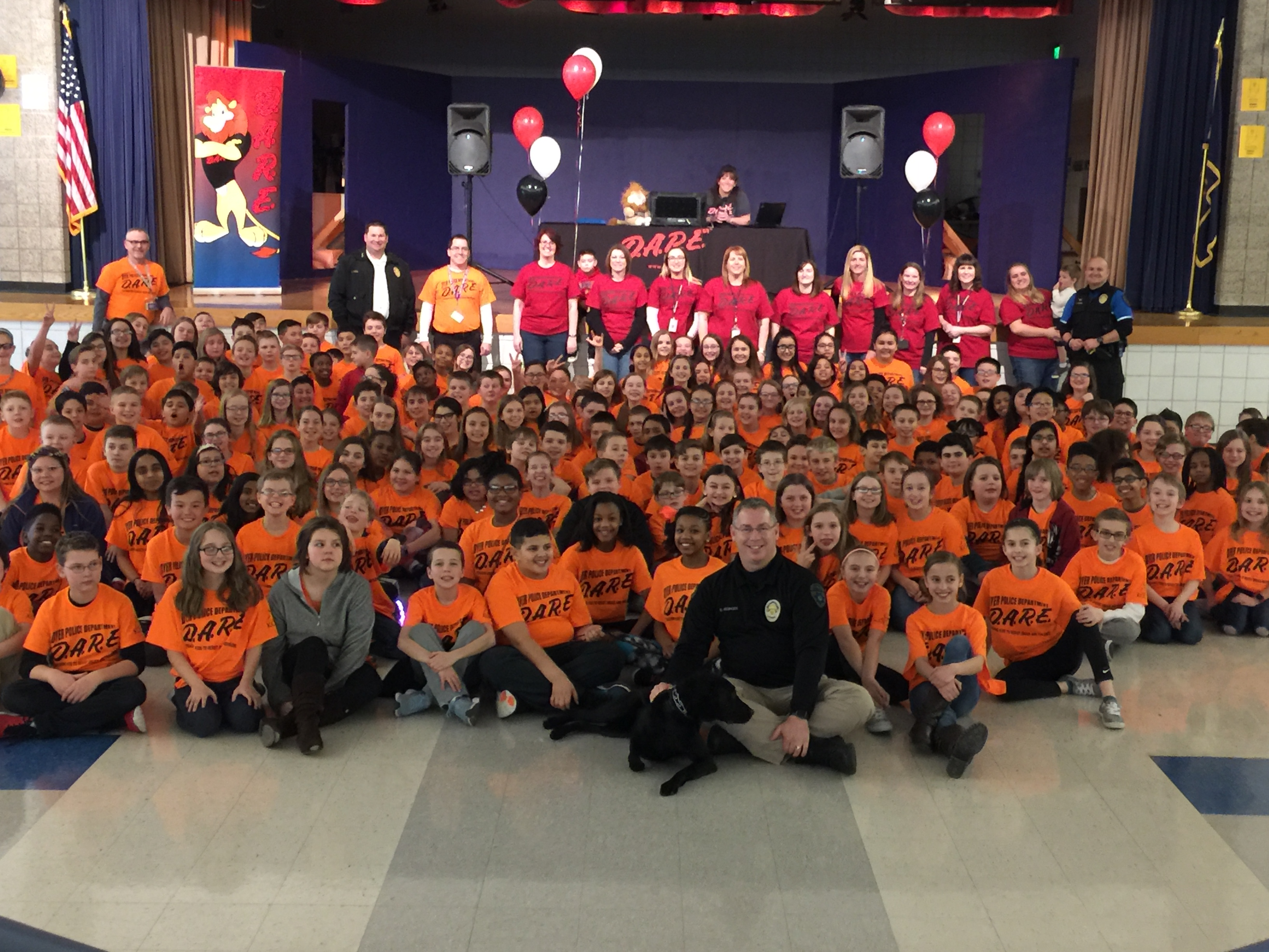 Officer Kissinger from Dyer Police Department in front of students during a DARE assembly at Kahler Middle School.