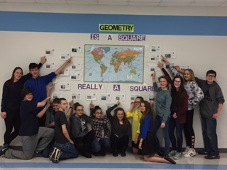 Students from Clark prove that Times Square is indeed a square.