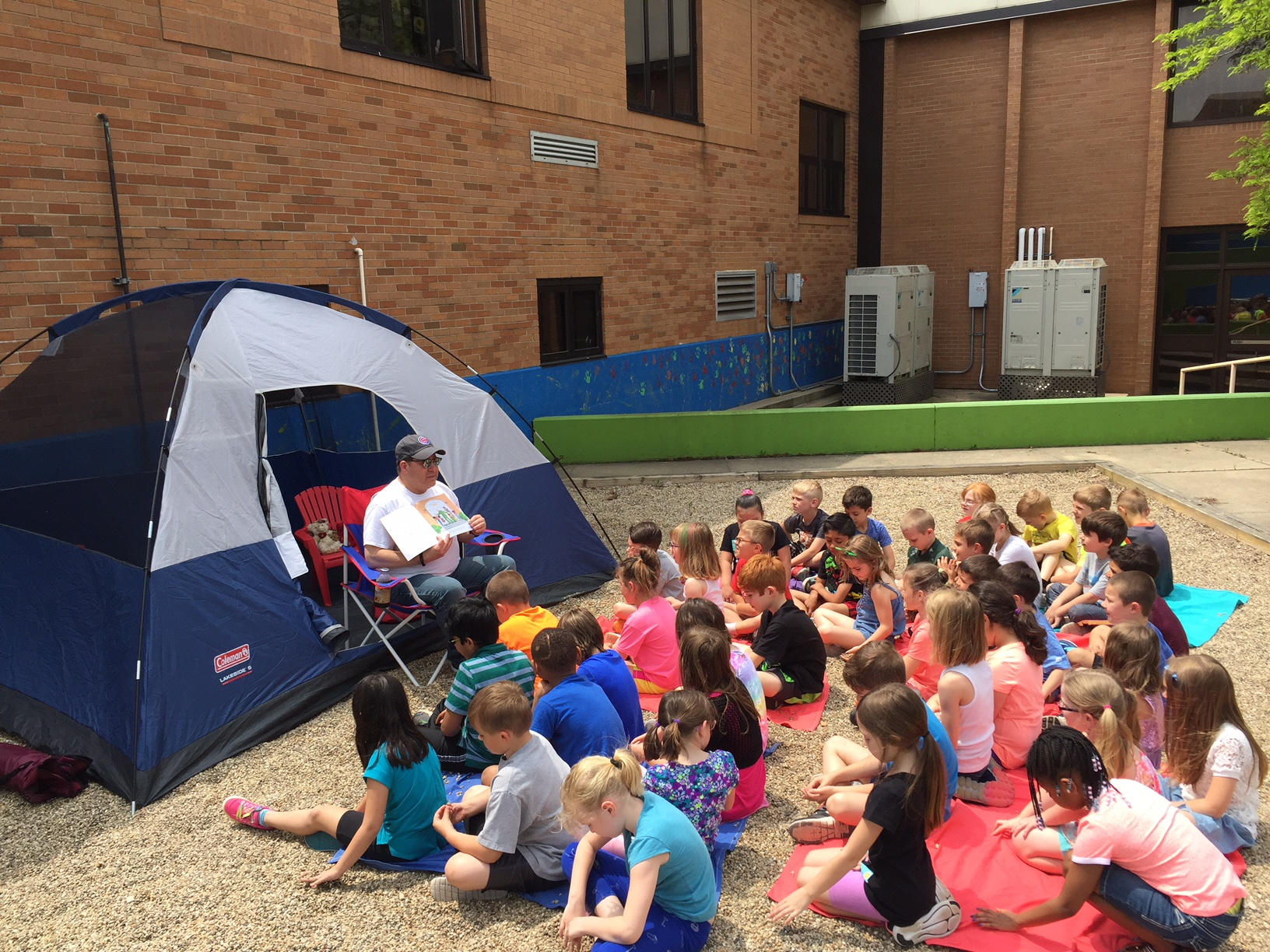 "Peifer students ""Camped Out with some Good Books"" with Mr. DeLaughter."