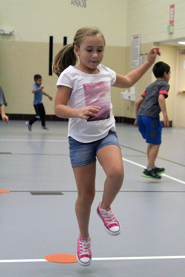 A girl skips in gym class