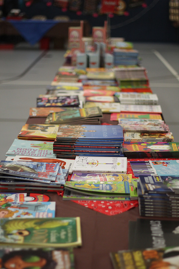 Books line the table at the Book Fair.