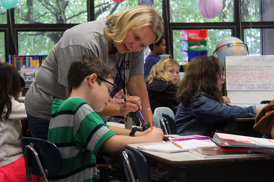 Mrs. Huffman helps a student with homeword