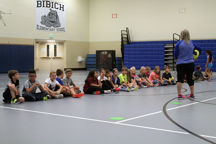One of the fourth grade classes listens to the instructions of the game they are about to play