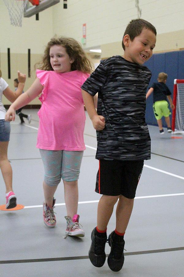 Students jump from circle to circle