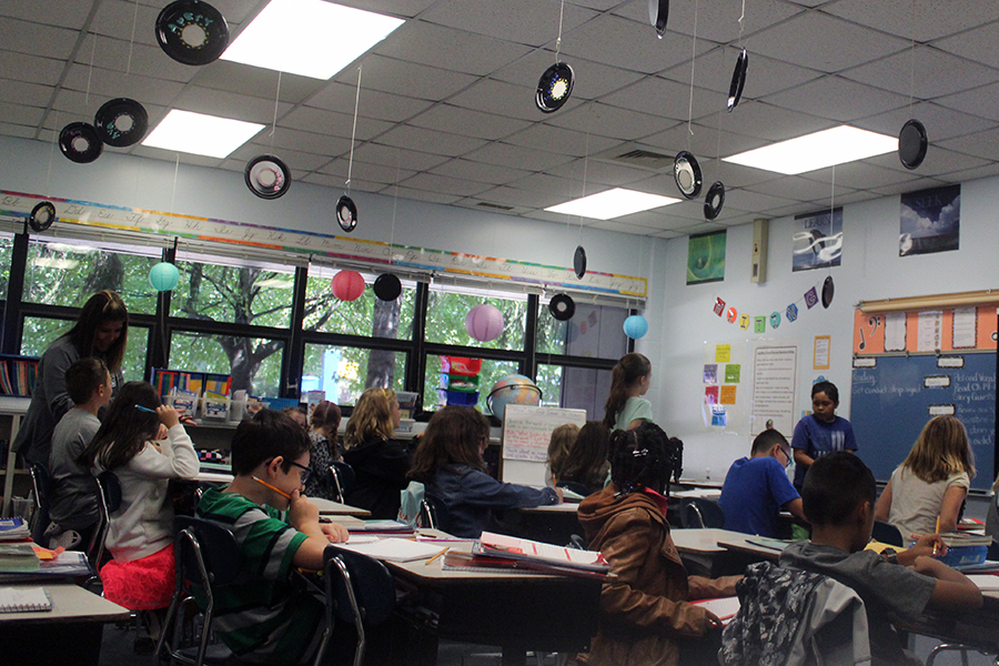 Mrs. Huffman's class go over their homework answers