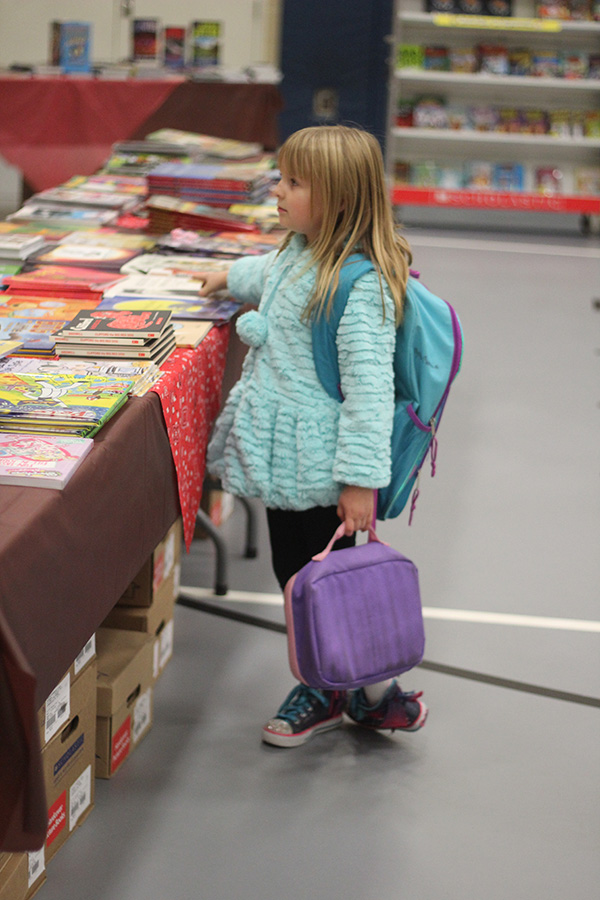 A girl shops around at the Book Fair.
