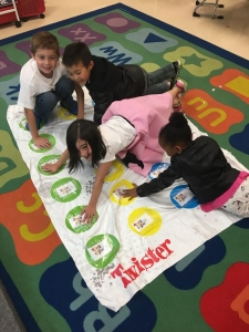 Kindergarden students play Twister.