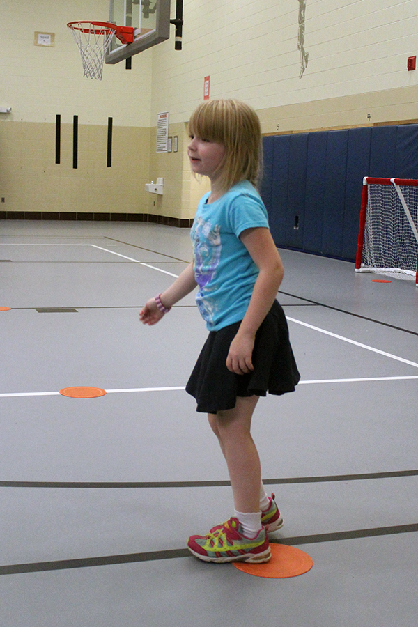 A girls skips during a game in gym class