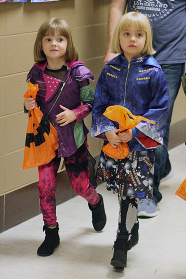 Two girls walk around the Boo Bash.