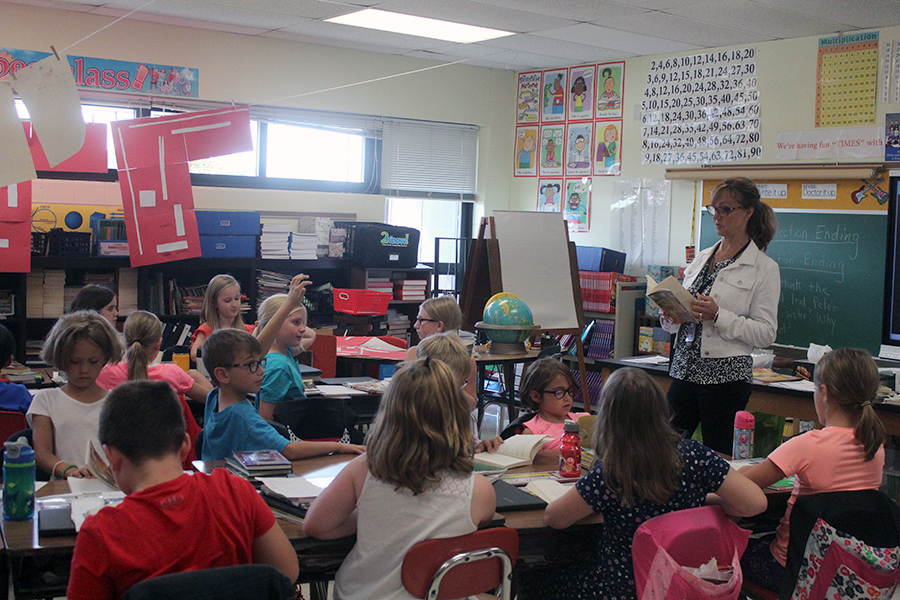 Mrs. Crary reads a book to her third grade class