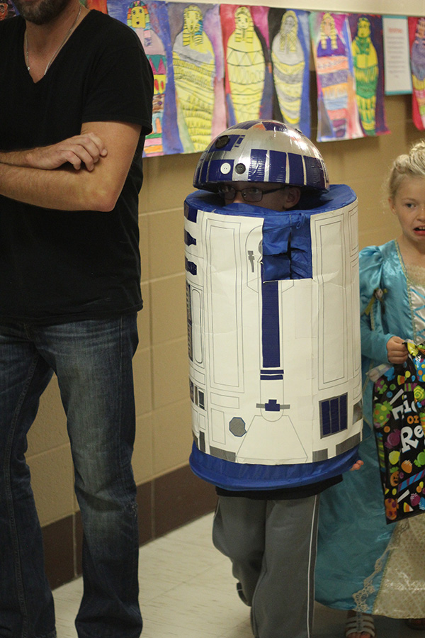 A boy dresses as R2D2.