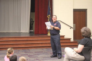 A fire fighter from the Dyer Fire Department speaks to a Protsman teacer.