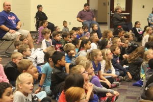Protsman students sit during a fire prevention assembly.