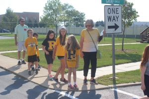 Protsman students pratice how to safley cross the street.