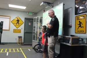 Dyer Police Department shows students how to safley cross the street.