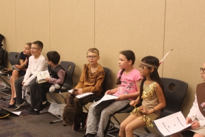 Protsman students sit and wait for their turn in Historical Halloween.