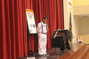 A boy is dressed as a astronaut for Halloween.