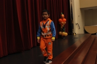A student is dressed as a construction worker.