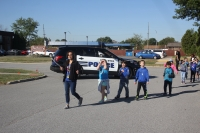 Protsman students return to Protsman while being protected by the Dyer Police Department.