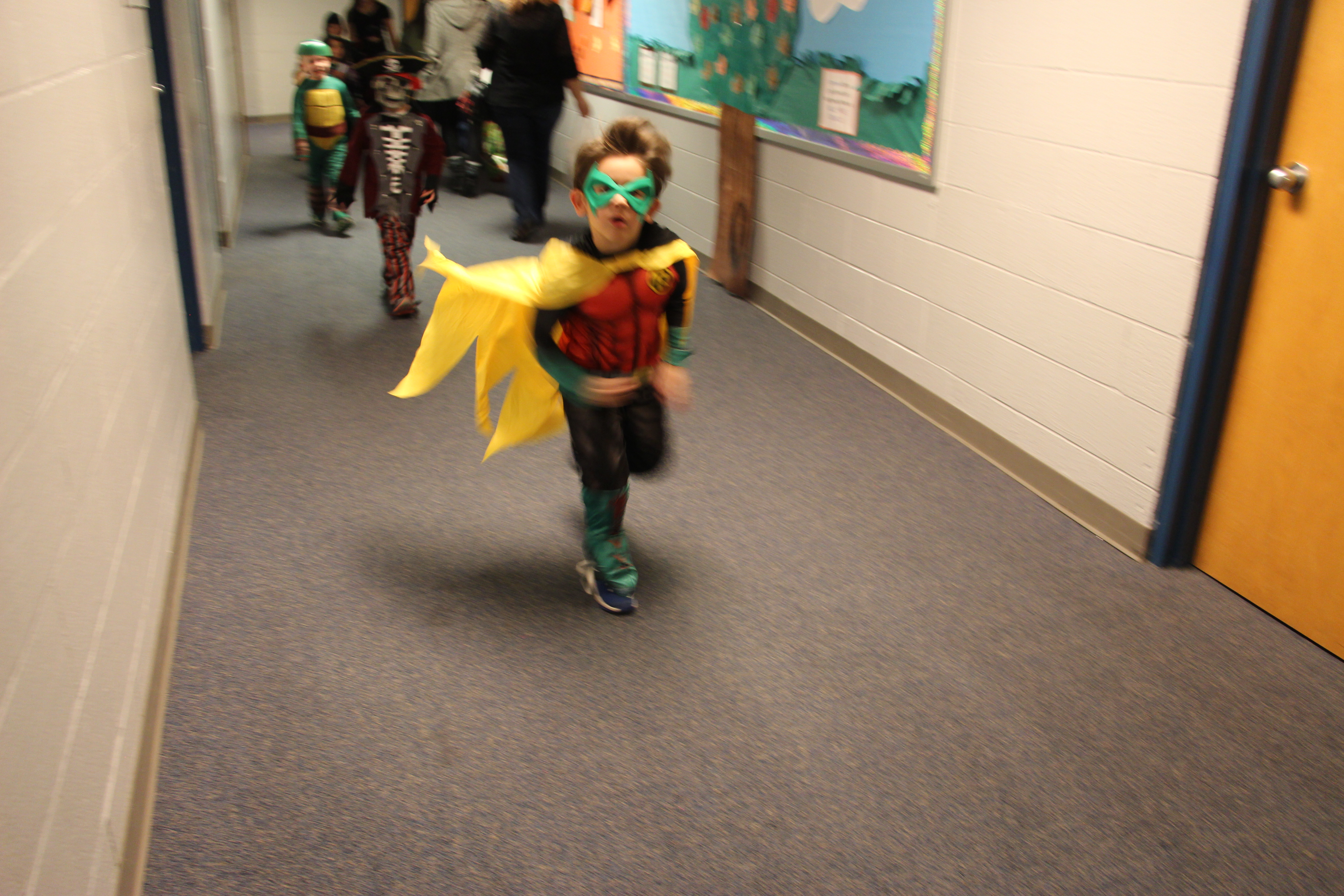 A student wears a Robin costume.