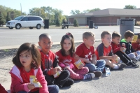 Protsman students sit and have a snack after returning from their walk.