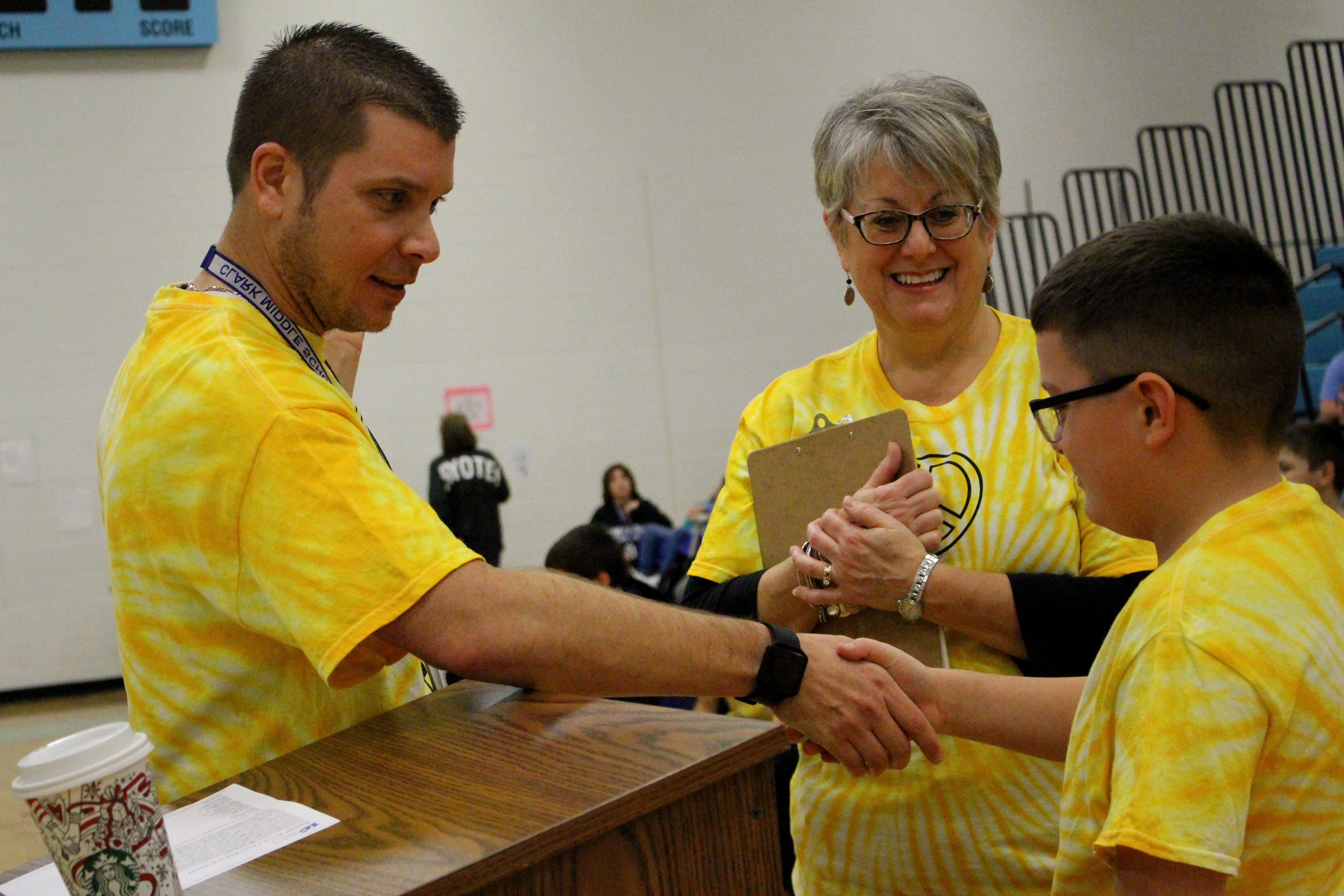 Stanicz shakes student's hand