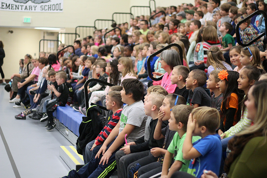 The students watch the acrobats.
