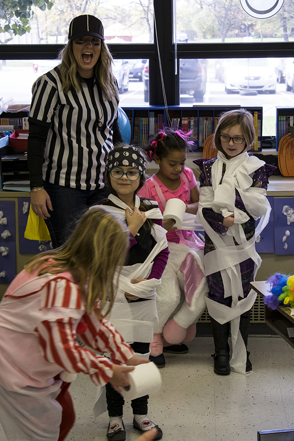 students wrap peers in toilet paper for halloween