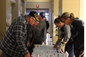 Veterans check in.