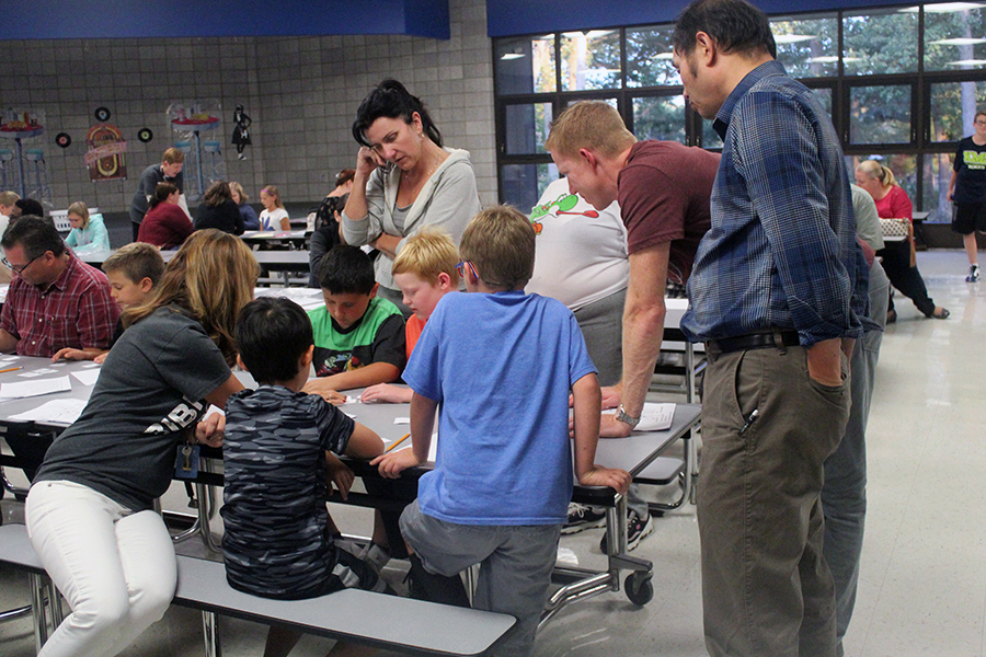 Mrs. Crary helps a family with a math game