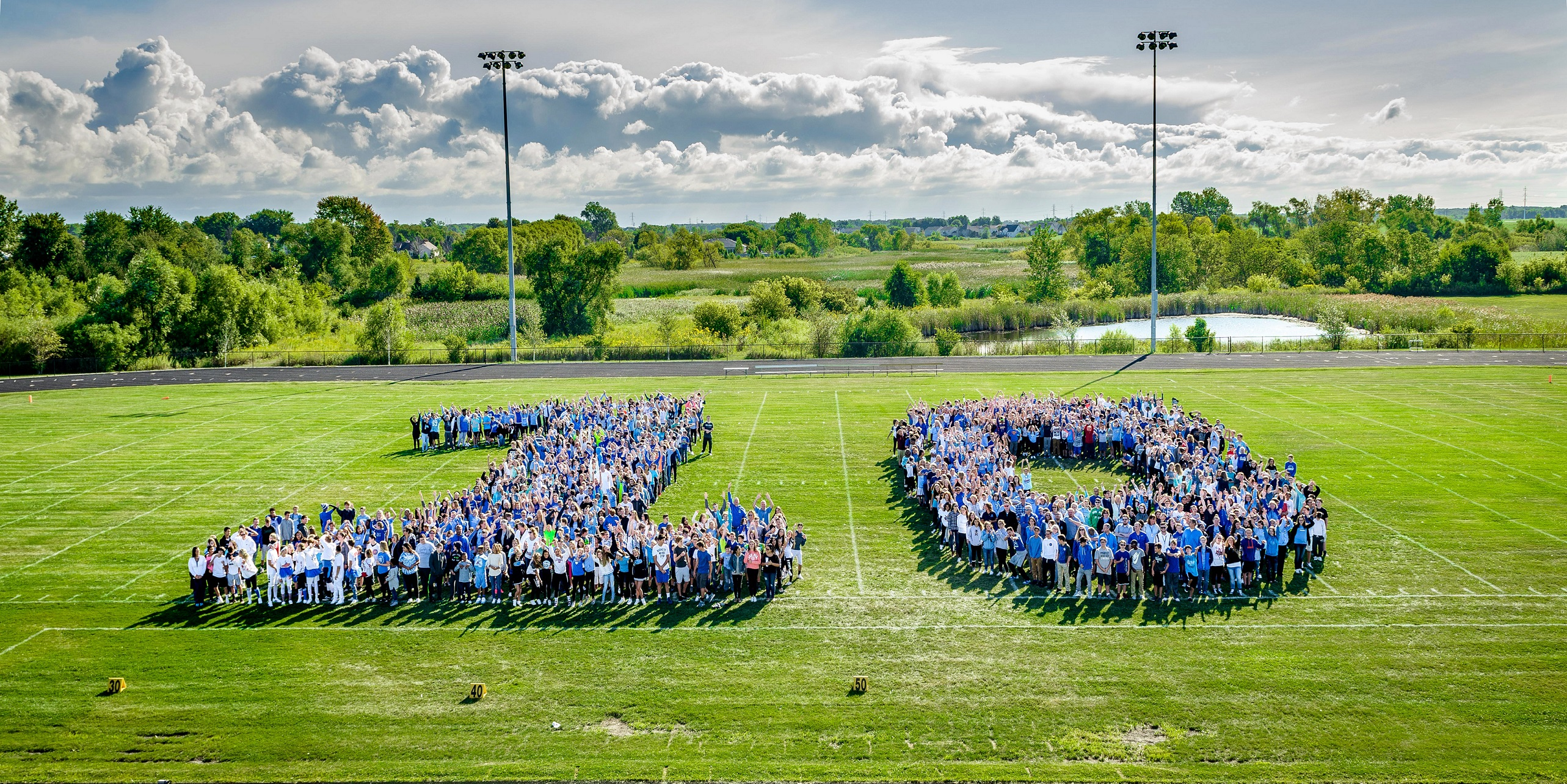 Clark MS students and staff members enjoy the weather and pose for a picture to celebrate the 10th Anniversary opening of the school!