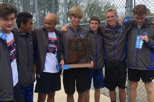 Boys Cross Country smiles with their new trophy