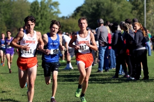 Luke Persun (10) is passed by two Laporte boys.