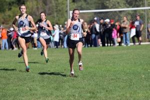 Girls Varsity cross country races towards the finish line.