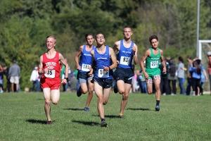 JV boys team runs towards the finish line, giving it their all.