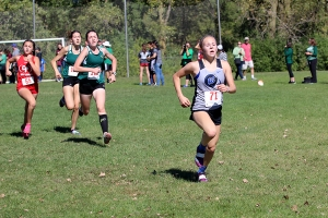 Sophia Born (11) runs towards the finish line.