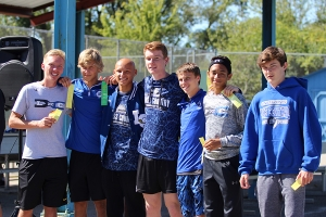 Karisa Candreva snaps a picture of the boys cross team.