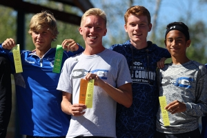 Boys Cross Country smiles with their new ribbons