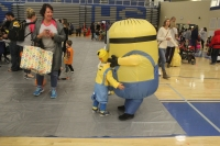 Two minions hug one another