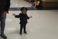 A girl walks down the hallway in a police uniform