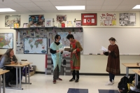 students read their scripts while performing