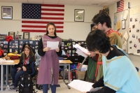 students perform a play
