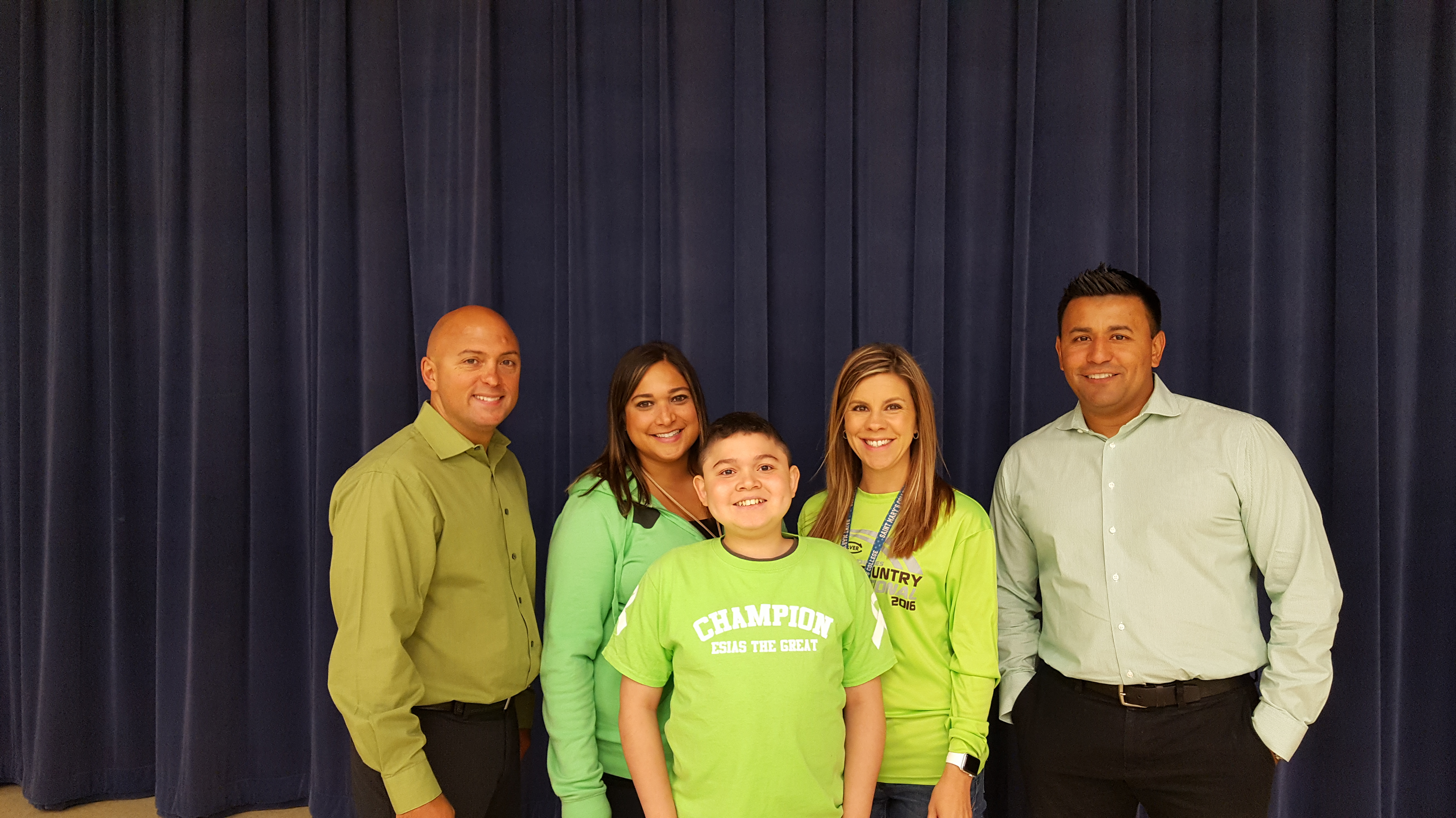 On September 7th, Grimmer students and staff honored World Duchenne Muscular Dystrophy Awareness Day by wearing green. Pictured with some Grimmer staff is 7th grade student Esias Santiago, who is bravely battling the disease.