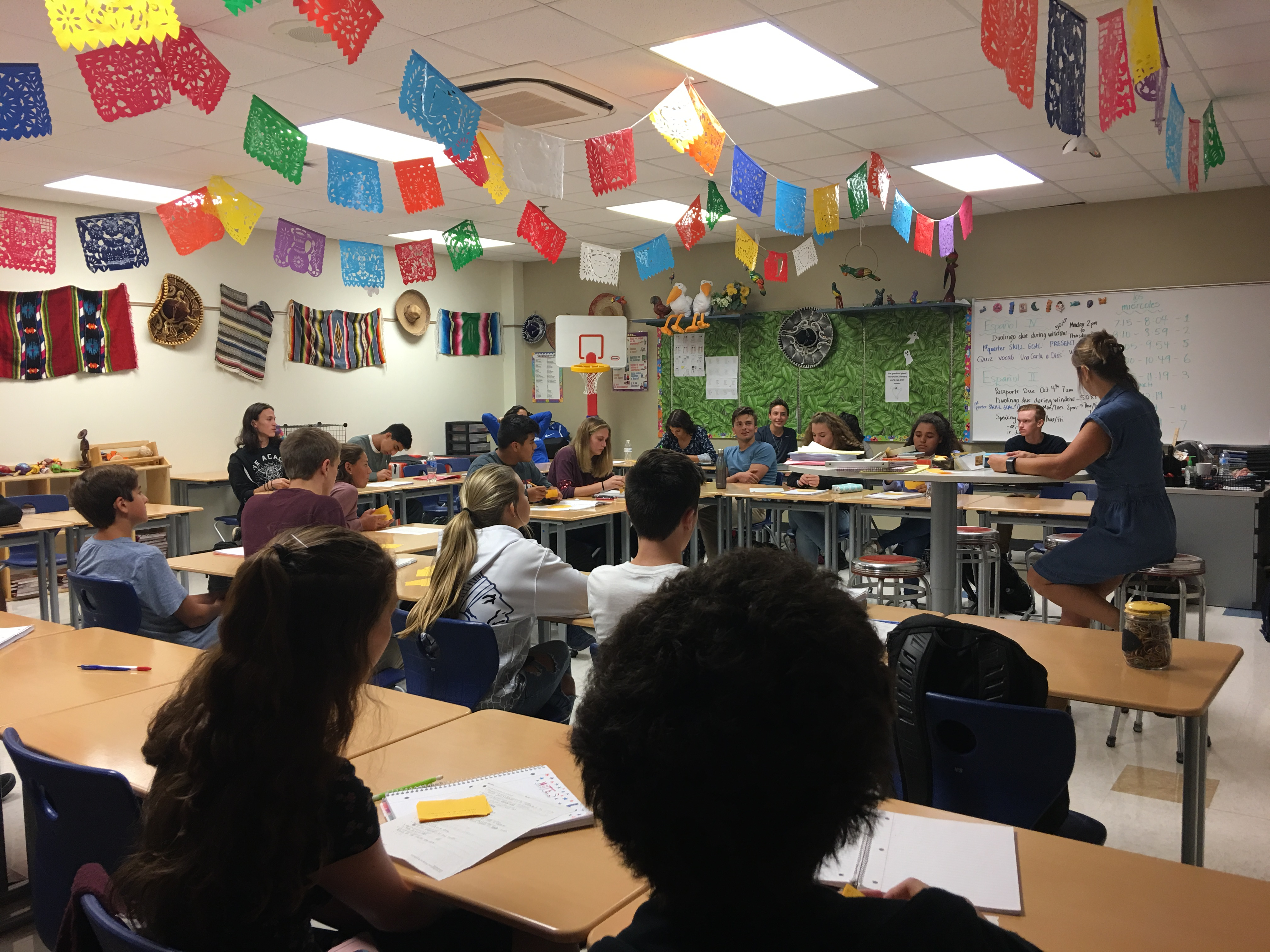 Mrs. Schneider teachers her class spanish.