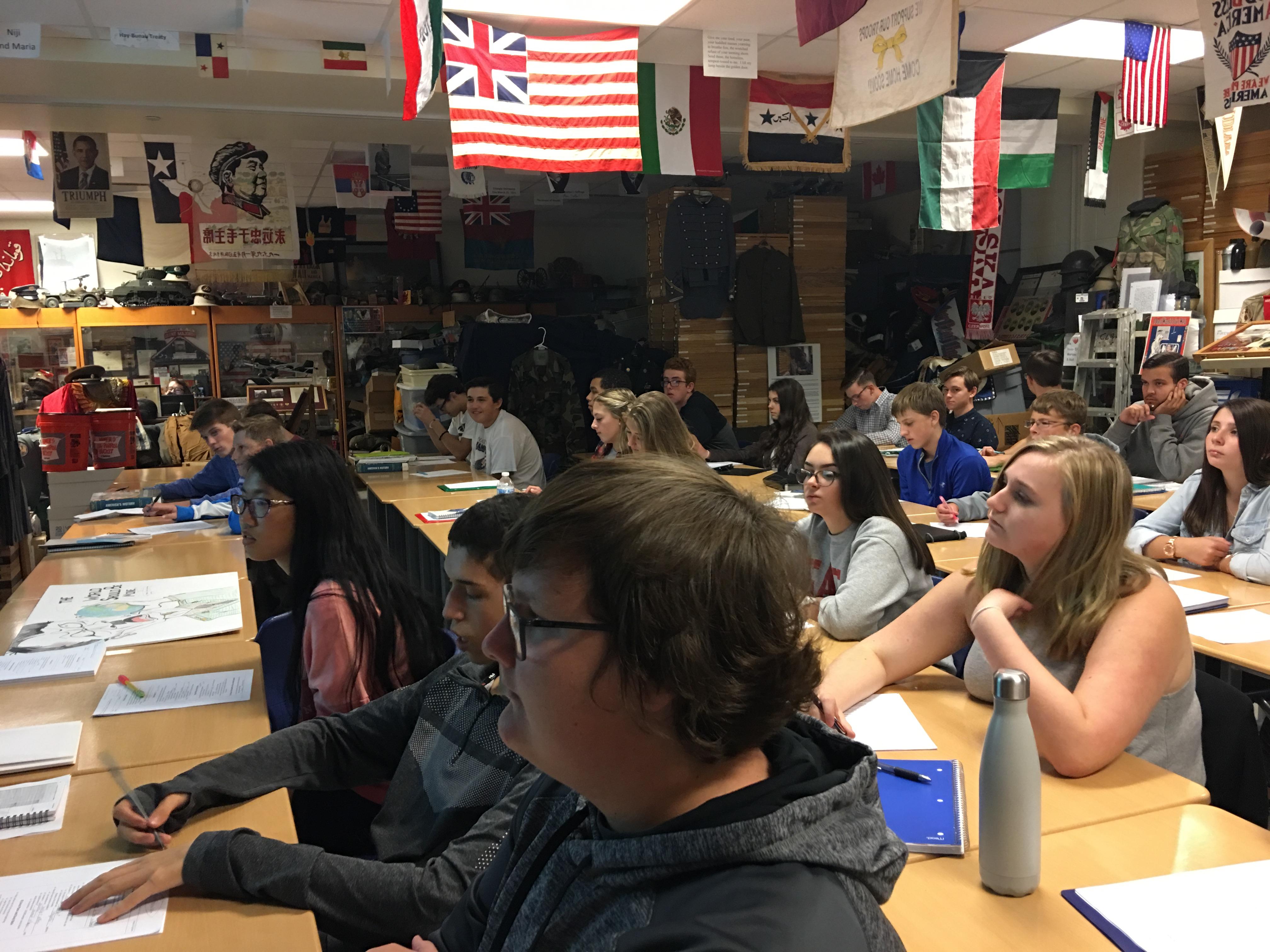 Social Studies class listens to Mr. Clark.