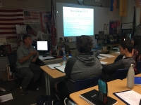 Mr Thomas Clark teaches his students.