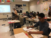 Students work on their French homework.