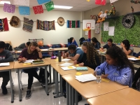 students work on paperwork.