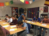 Spanish students get help from their teacher.