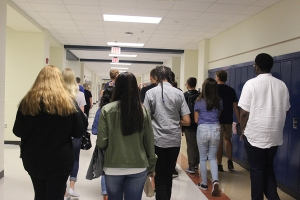 students walk down the hallway for the first time on the second floor